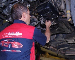 Auto mechanic working on a European car repair at the foreign aid